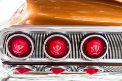 Tail lights on a custom car. Chrome inset and red bulb tail lights on a custom car royalty free stock photo