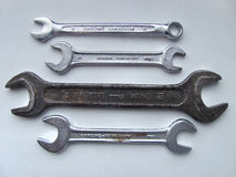Chrome and iron wrench. Set of the chrome and iron wrench on the light surface. Different size Royalty Free Stock Photos