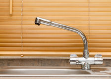 Chrome kitchen tap Stock Images
