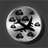 Chrome knob with airplane and clouds. Chrome volume knob with airplane and clouds on the metallic background Stock Photo