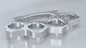 Chrome Knuckle Duster. A shiny chrome knuckle duster in a studio environment Royalty Free Stock Photos