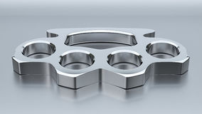 Chrome Knuckle Duster. A shiny chrome knuckle duster in a studio environment Stock Image