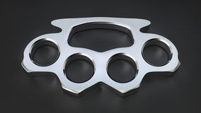 Chrome Knuckle Duster. A shiny chrome knuckle duster in a studio environment Stock Photos