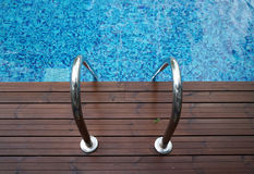 Chrome ladder into swimming pool Stock Photos