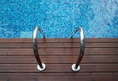 Chrome ladder into swimming pool Stock Photos