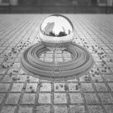 Chrome levitating sphere. With reflections located in the center of the town square below her belt circles and small cubes. Abstract background wallpaper in Royalty Free Stock Photos