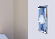 Chrome light switch in a modern kitchen Stock Photography