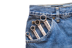 Chrome lug  spanner in front blue jeans pocket on white isolated background Stock Photography