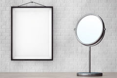 Chrome Makeup Mirror in front of Brick Wall with Blank Frame Stock Images