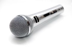 Chrome microphone. Closeup of a dynamic microphone isolated on white royalty free stock images
