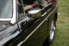Chrome mirror in an old car. Accessories in cars exhibited at sh stock photos