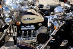 Chrome of Motorcycle. Tricked-out motorcycle image with focus on chrome of engine and gas tank paint job Royalty Free Stock Images