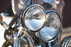 Chrome motorcycle headlight lamp Stock Photography