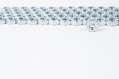 Chrome muttrar solated på vit bakgrund Royaltyfri Bild