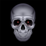 Chrome mystic skull. Chrome mystic skull with red sparks in the eyes on black background royalty free illustration