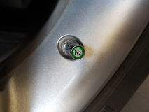 Chrome Nitrogen (N2) Valve Cap on TPMS Sensor royalty free stock photography