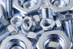 Chrome nuts and bolts. Lying together in a pile Stock Photos