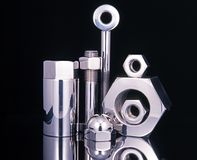 Chrome nuts and bolts. Stock Photo
