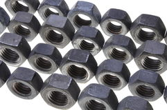 Chrome nuts hard work Stock Photos