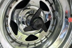Chrome-plated car wheel rim. Day Stock Images