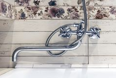 Chrome-plated faucet in the interior of the bathroom stock images