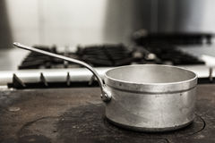 Chrome pot standing on hotplate Stock Photography