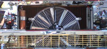 Chrome radiator and fan. Close up of custom car highly polished radiator and fan Royalty Free Stock Image