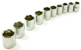 Chrome ratchet sockets in a curve, on white Royalty Free Stock Image