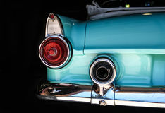 Chrome rear tail lights, bumber and exhaust of convertable aqua. Chrome rear tail lights, bumper and exhaust of convertable turquoise Thunderbird vintage car stock photos