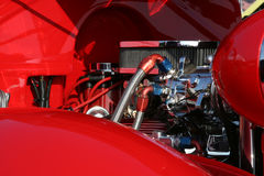 Chrome and Red. A classic red hotrod with plenty of chrome under the hood Stock Images
