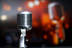 Chrome retro microphone close-up, karaoke. Background music royalty free stock photography