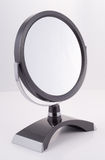 Chrome round Mirror with Stand. Round modern Mirror for the bathroom, luxury goods Royalty Free Stock Photos