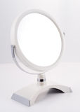 Chrome round Mirror with Stand. Round modern Mirror for the bathroom, luxury goods Stock Photo