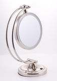 Chrome round Mirror with Stand. Round modern Mirror for the bathroom, luxury goods Royalty Free Stock Image