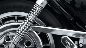 Chrome Shock. A close up of a shock and part of a rear tire of a motorcycle royalty free stock photo