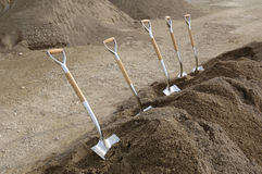 Chrome Shovels in Dirt. Chrome Ground Breaking Shovels in Drt Royalty Free Stock Photos