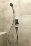 Chrome shower in the bathroom. On the brown tile Royalty Free Stock Image