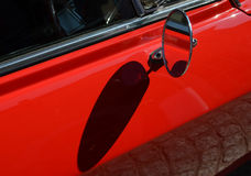 Chrome side rear view mirror on a classic car. Stock Images