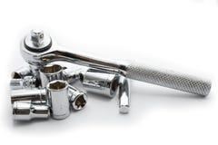 Chrome socket wrench set. Socket wrench set on white with wrench on socket royalty free stock image