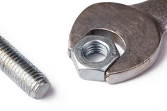 Chrome spanner with nut and bolt Stock Photos