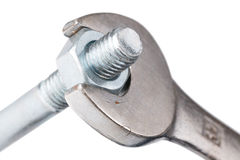 Chrome spanner with nut and bolt Royalty Free Stock Photos