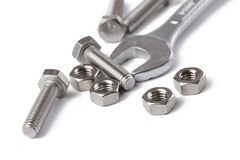 Chrome spanner with nuts and bolts Royalty Free Stock Image