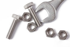 Chrome spanner with nuts and bolts Royalty Free Stock Photo