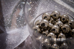 Chrome spheres in clear glass next to the window. Stock Images