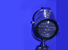 Chrome stage light on blue background. Stock Photos