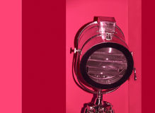 Chrome stage light on red background. Stock Photo