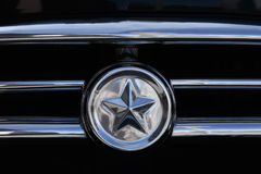Chrome star with lines. Car grill from Zhýkovskaya Volga Royalty Free Stock Photography