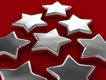 Chrome stars on red Stock Images