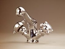 Chrome steel tap faucet. Steel chrome water faucet Stock Images
