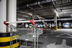 Chrome store trolley at underground parking royalty free stock photo